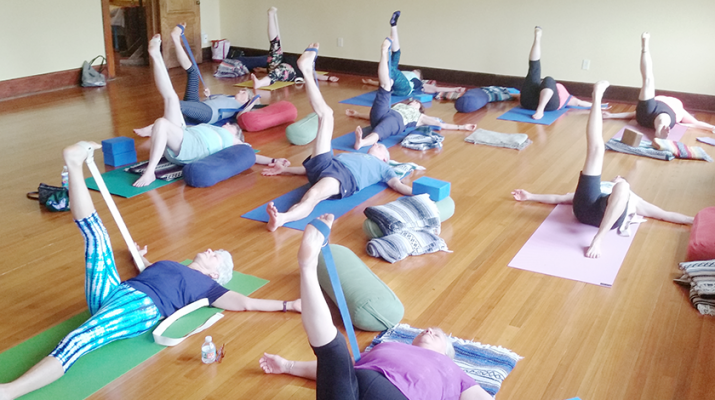 Yoga students at Beyond Yoga in Brockport. Many of them are over 55 years of age. They say practicing yoga improves their health and overall happiness. Photo by Christine Green