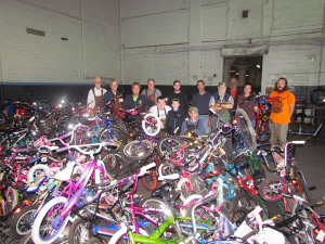 Part of a group of volunteers who dedicate 18,000 hours repairing and distributing 2,000 bicycles to dozens of community organizations, needy families and individuals with disabilities in Rochester every year. In addition, volunteers perform nearly 3,000 repairs for individuals, many of whom depend on a bicycle as their main source of transportation. Photo provided.