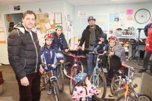 Members of a refugee family getting their bikes through R Community Bike. Photo provided.