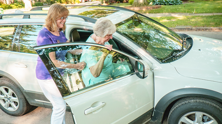 A senior getting a ride with a volunteer at Lifespan. Photo courtesy of Gelfand-Piper Photography.
