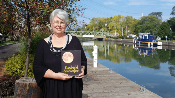 "Cancer survivor Terry Werth, 71, in front of the Erie Canal. She has recently published ""Goodnight Spencerport,"" a children's book set in the west side village of Spencerport."