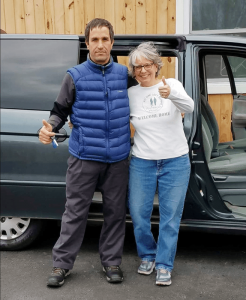 No One Left Behind – Rochester Chapter President Ellen Smith is pictured with a refugee who recently received a car as part of Operation Wheels for Work. The refugee received a special immigration visa for helping American troops in Iraq and Afghanistan.
