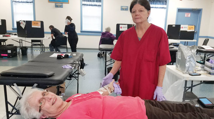 Staff member Colleen Calnan, 62 ,of Irondequoit, helps donor Sandra Phillips, 75, of Clarkson, with her blood donation at a Brockport blood drive. Phillips has been donating blood for over 20 years.
