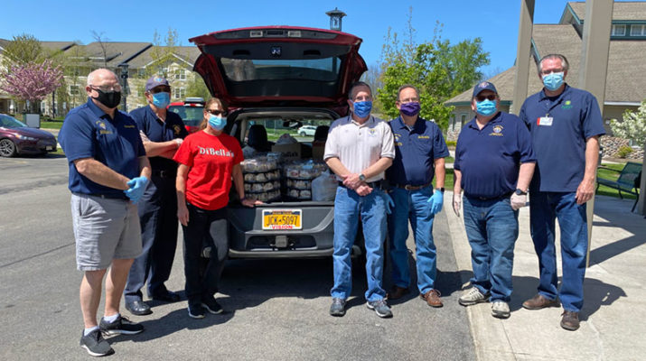 Members of The Finger Lakes Chapter Knights of Columbus delivering breakfast pizzas and subs to St. Ann's Community.