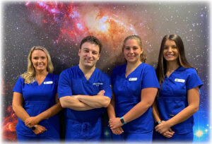 Dr. C with his dental assistants and hygenist at their office in Henrietta.