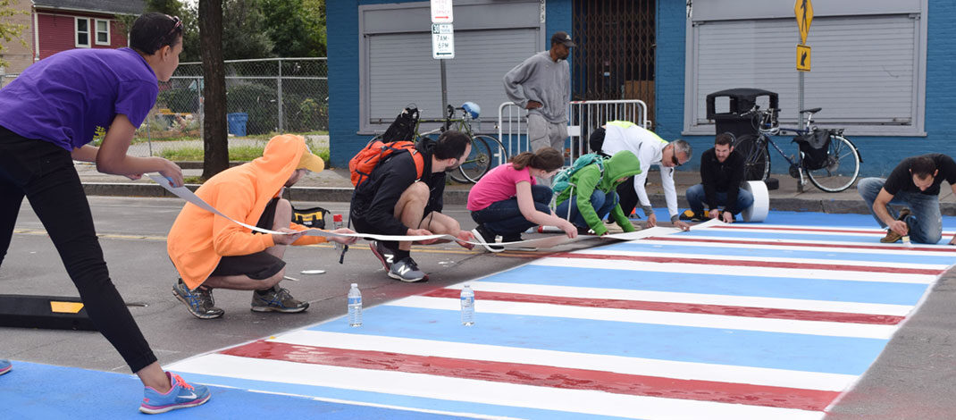 Common Ground Health has advocated for traffic safety, including colorful cross walks, higher visibility crosswalks around schools and playful sidewalk projects. Photos provided by Common Ground Health