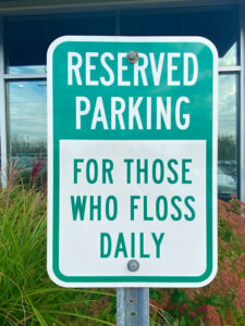 Sign at the parking lot of Celestial Dental on West Henrietta Road urges patients to floss. Photo courtesy of Linda Covington.