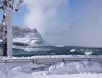 Niagara Falls never freezes entirely, however the combination of the cold and wind make this your winter wonderland workout. Shown is a mist rising above the falls at Niagara Falls State Park.