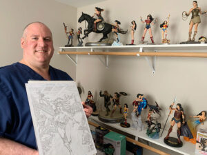 An entire room in Jarrod Atkinson's Greece home brims with Wonder Woman figures, posters, toys and dolls. He also has a smaller collection at his office at Unity Hospital, where he serves as director of nursing.