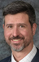 """Physician R. Matthew Kottmann is pulmonary director of the UR Medicine Comprehensive Sarcoidosis Program. """"Sarcoidosis is an example of your immune system going haywire and reacting to an unknown trigger leading to inflammation in the body,"""" he says."""